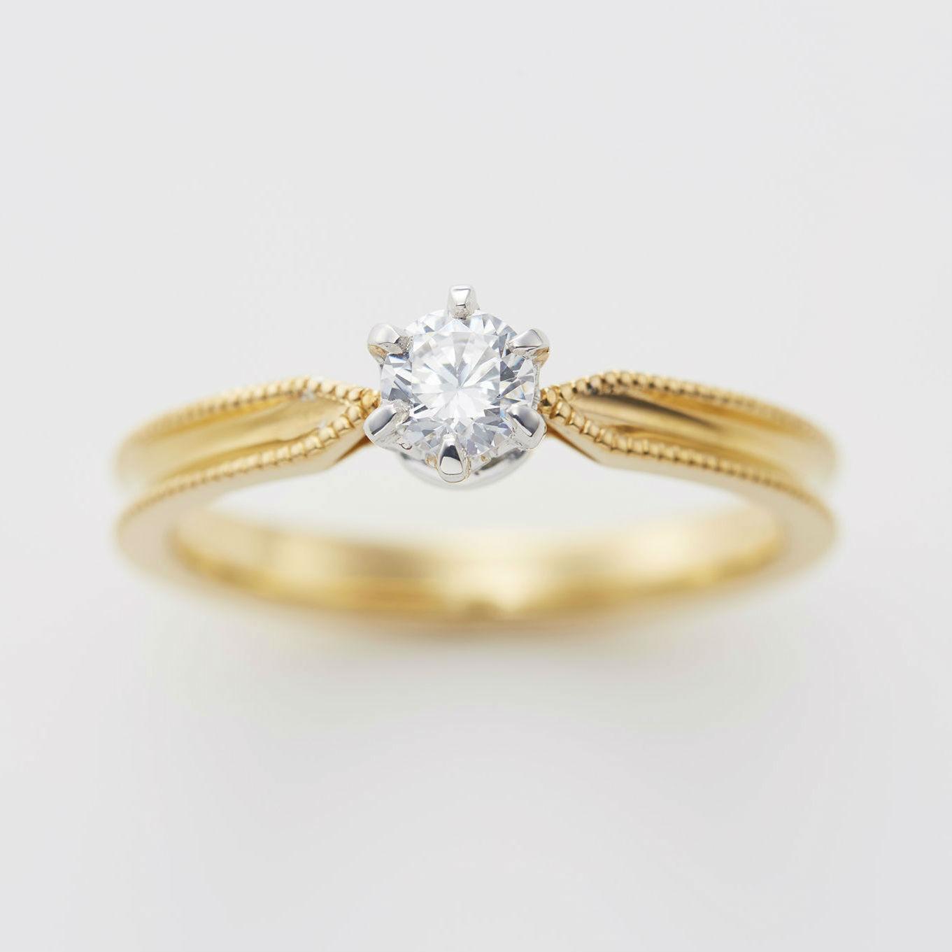 ミルグレイン(ミル打ち)を施したアンティークな婚約指輪